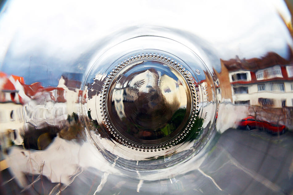 apartments through the bottom of a glass jar