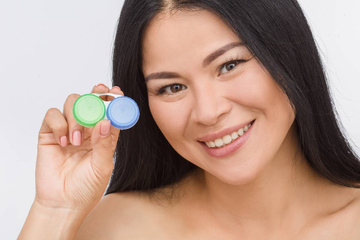 Asian woman holding contact lens case
