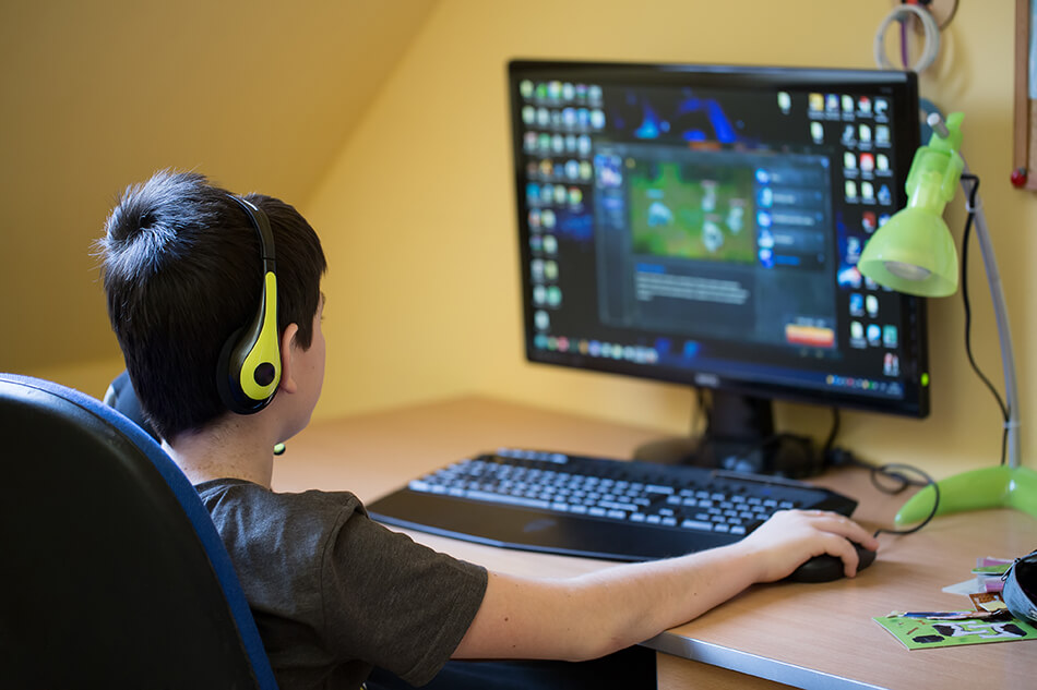 boy playing games on the computer