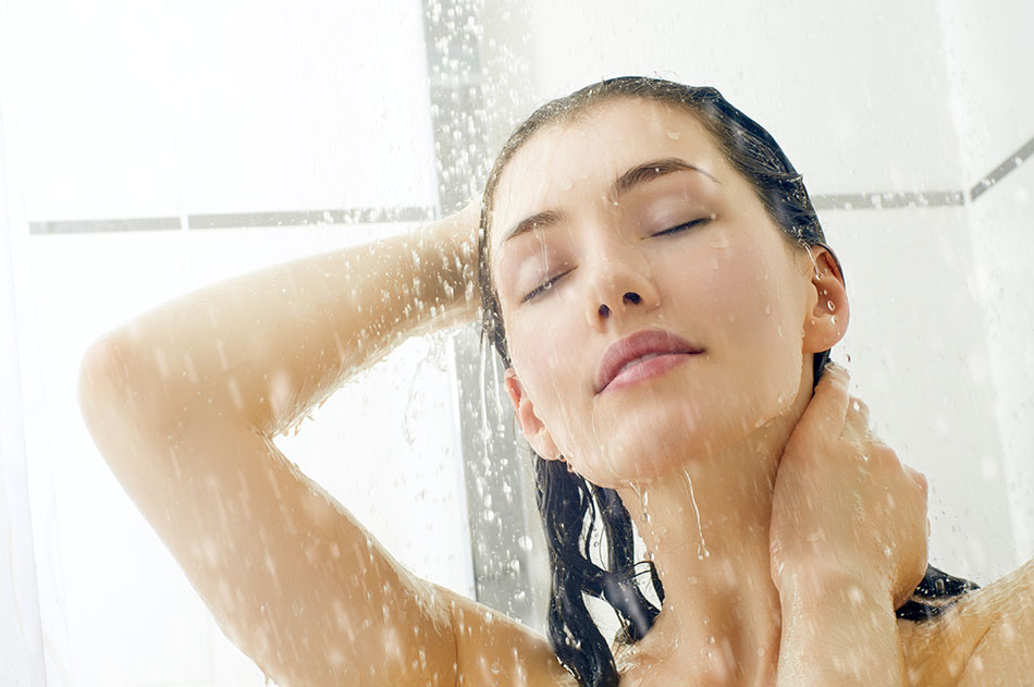 closeup of woman smiling in the shower