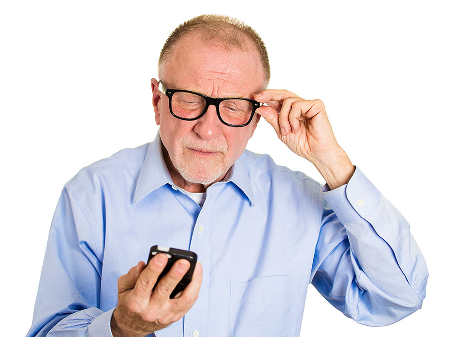 Elderly man with glasses squinting at phone