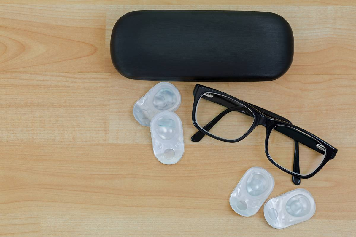 glasses case, glasses and disposable contacts on table