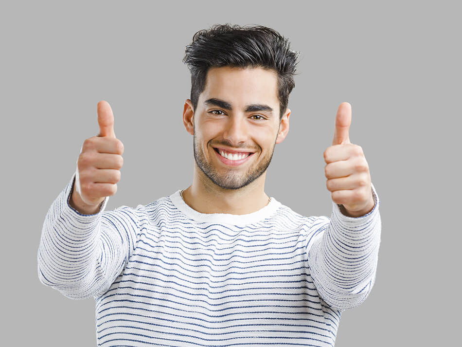 happy man wearing giving two thumbs up