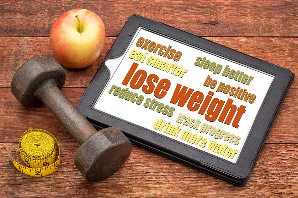 Dumbbell, tape measure, apple and sign for losing weight