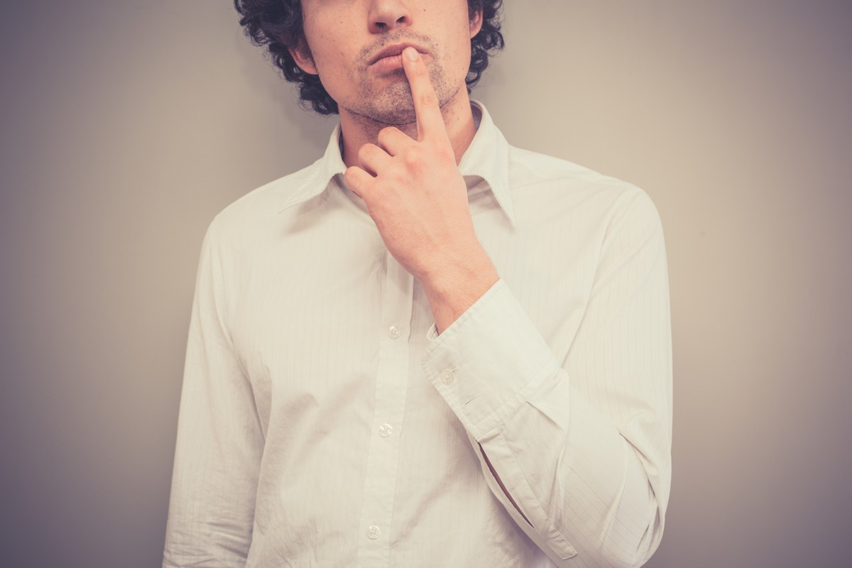 "man with finger on lip, thinking ""should I get contacts?"