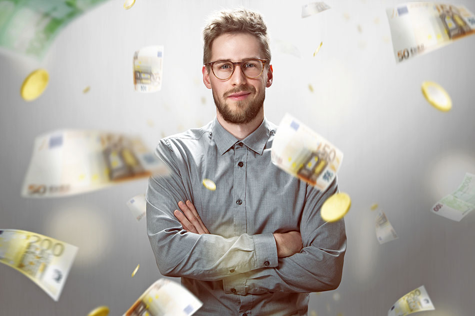 man with glasses standing and money flight around him