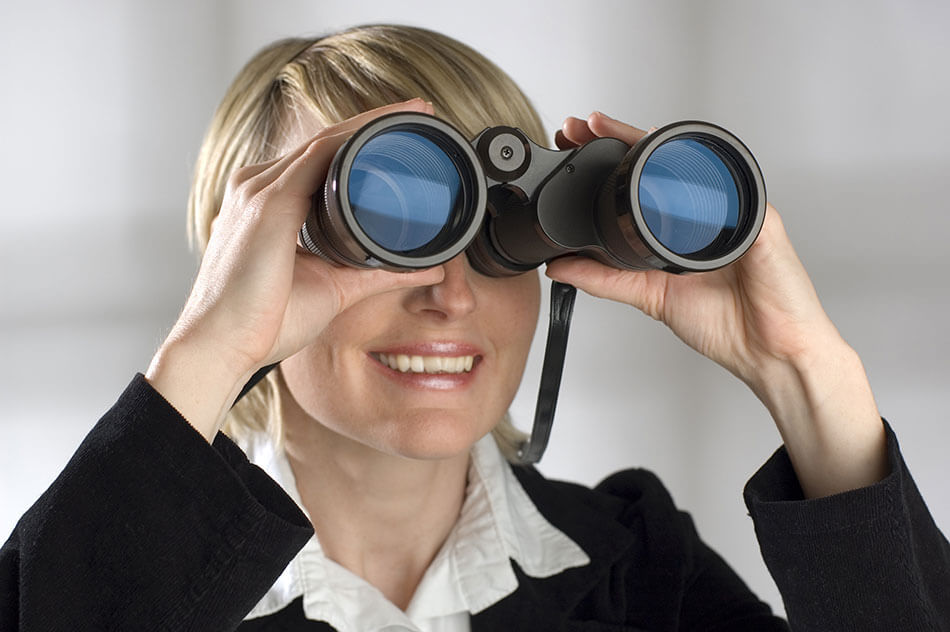 Middle aged woman looking through binoculars