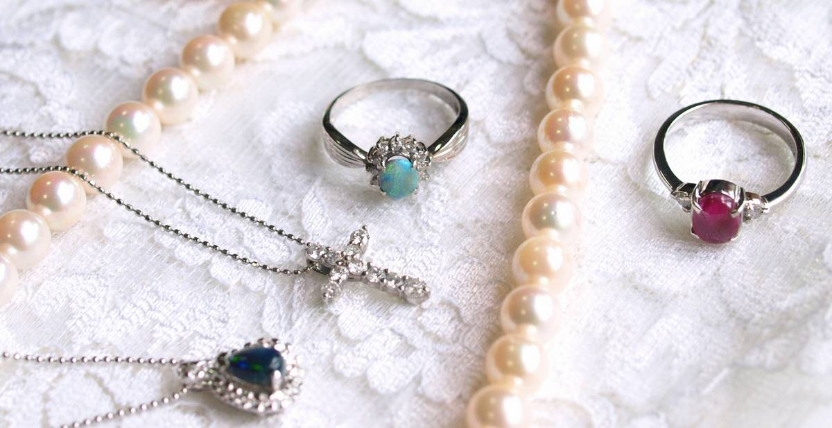 necklaces and rings on lace