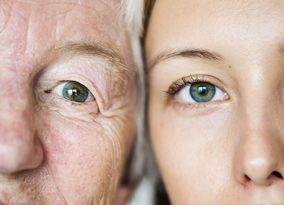 old woman and young woman with blue eyes