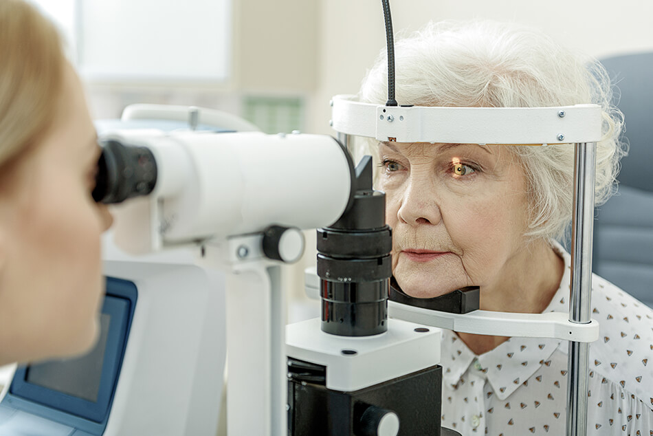older woman having an eye exam