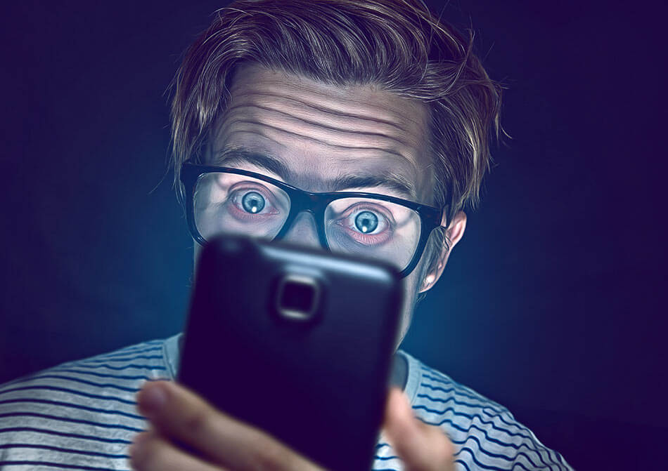 man staring into smartphone