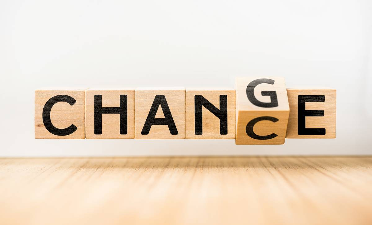 """change"" written on wooden blocks transitioning to ""chance"""