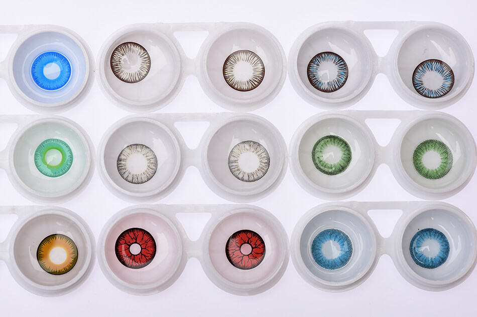 a tray of many contact lenses in different colors