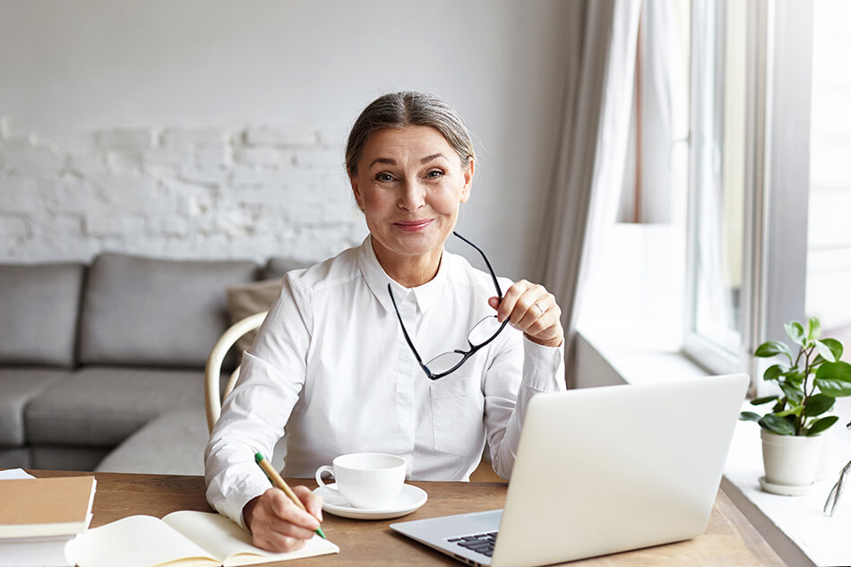 Woman sitting at desk with laptop in front of her
