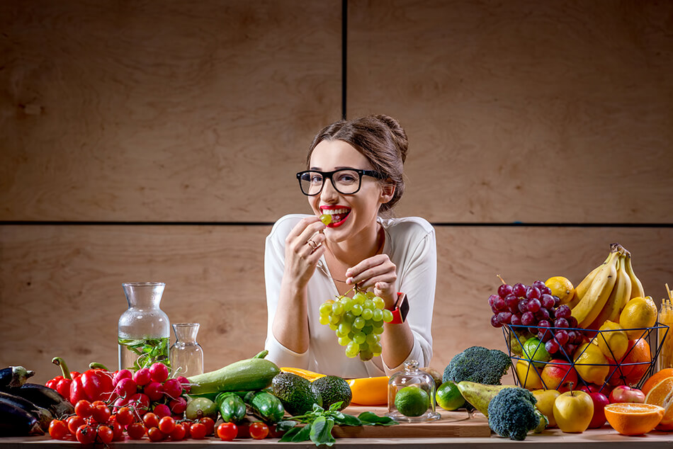 woman eating healthy diet and wearing eyeglasses
