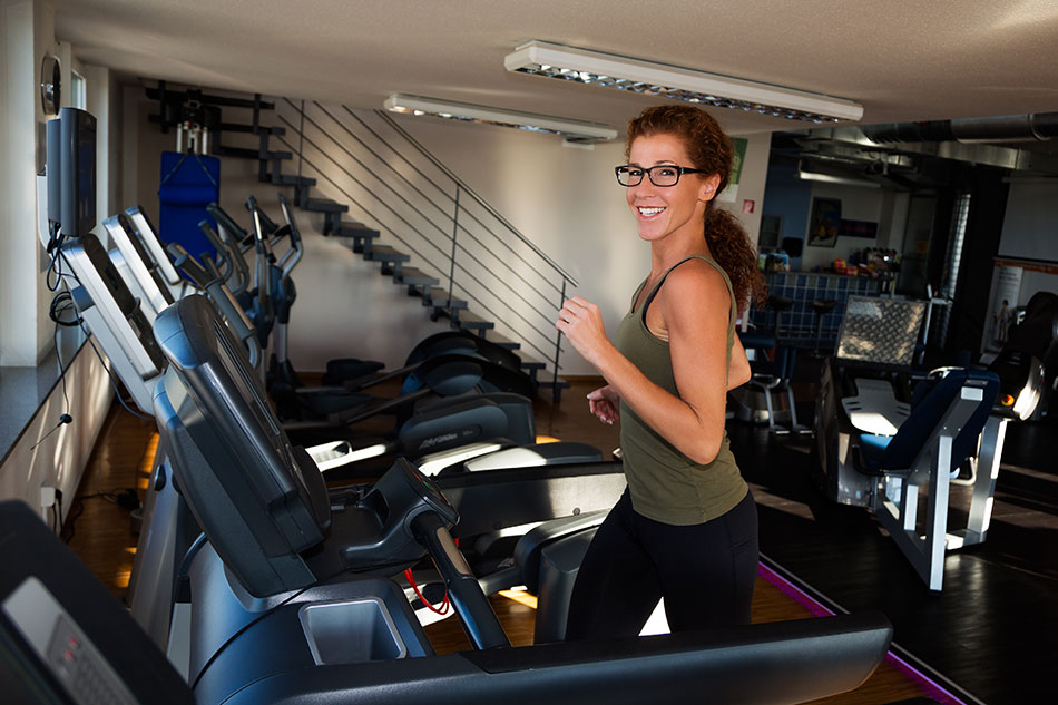 Woman with glasses on treadmill