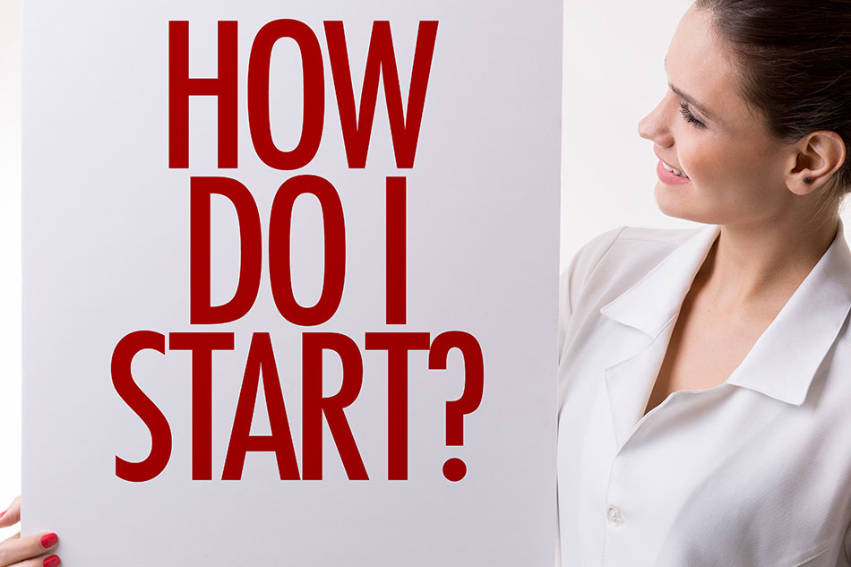 "Woman holding sign saying ""How do I start?"""