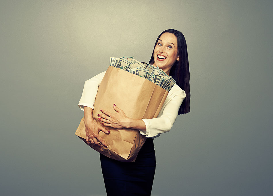 Woman hugging large paper bag full of money