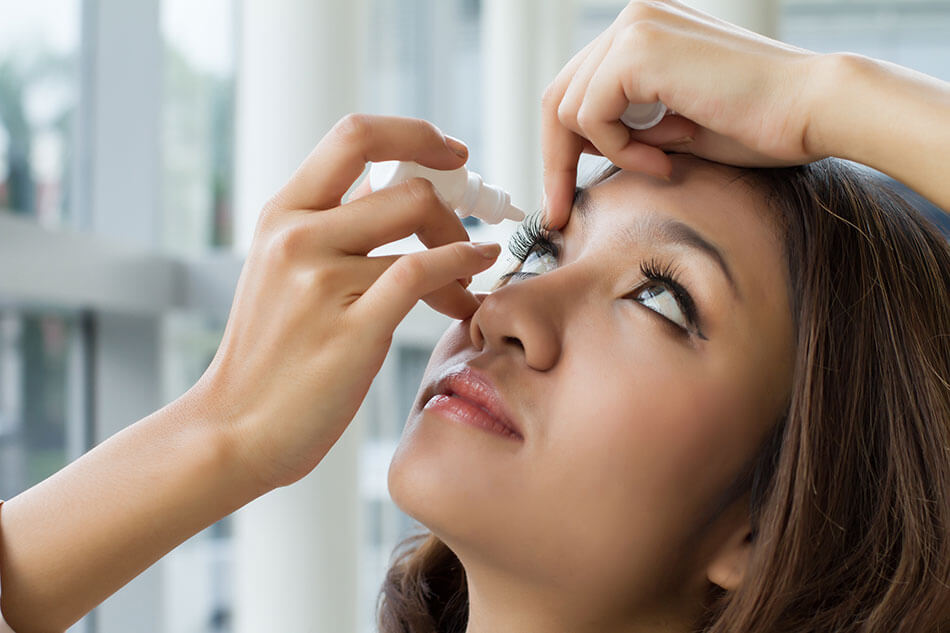 "Woman using saline drops in her eyes wondering ""why are my contact blurry?"""