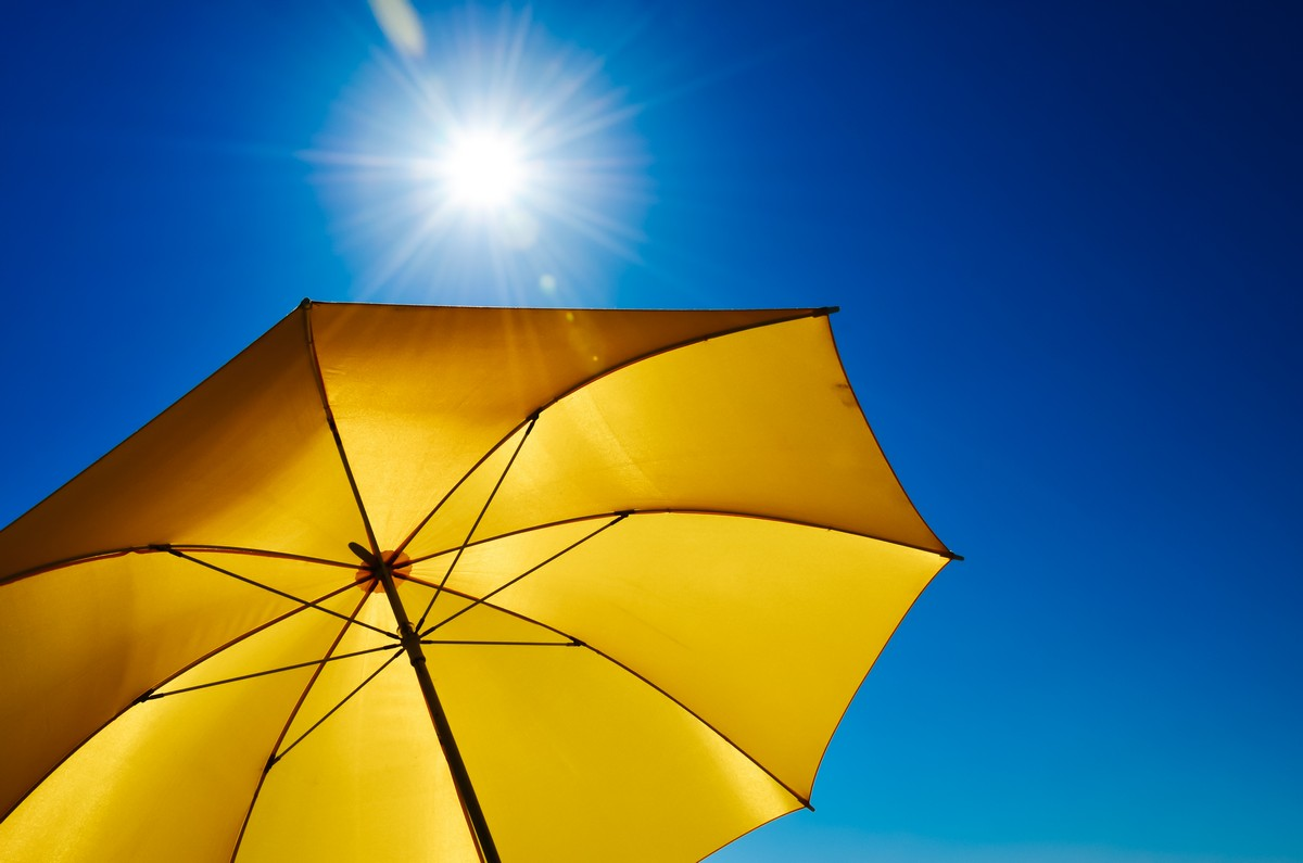 yellow umbrella blocking the sun's rays