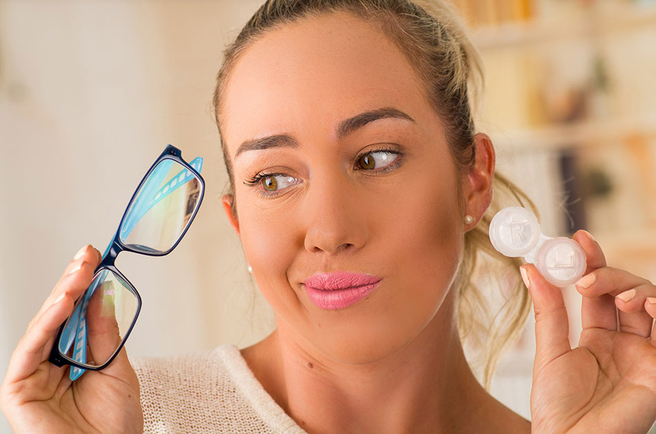 Young woman deciding between glasses and contacts with astigmatism