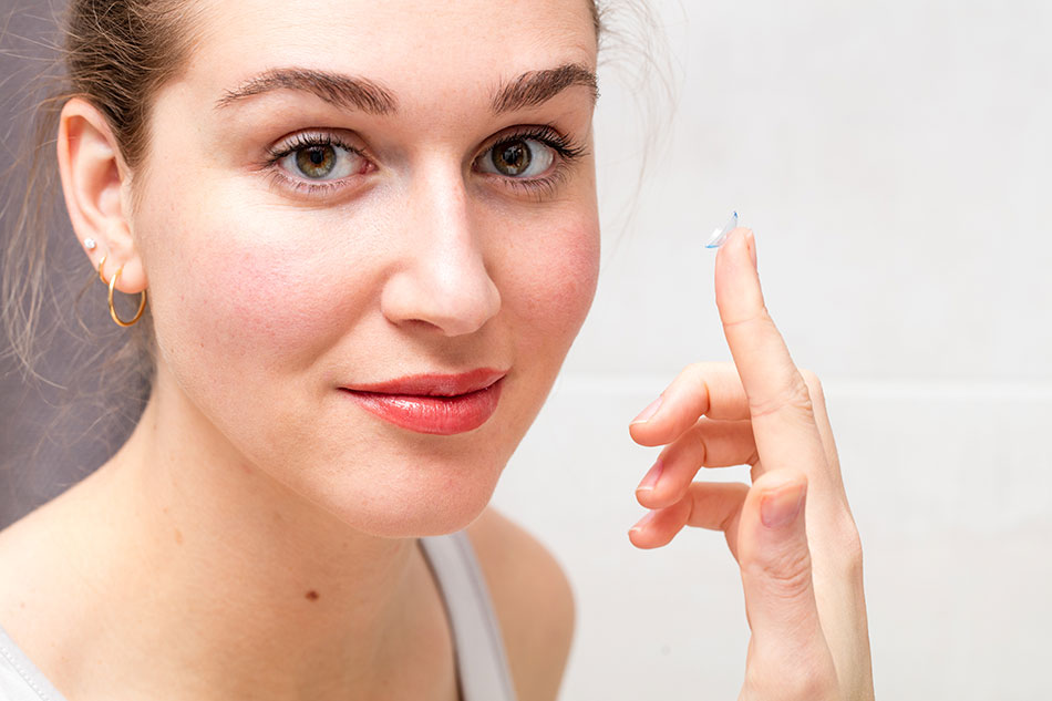 Young woman thinking to push contact lens expiration date